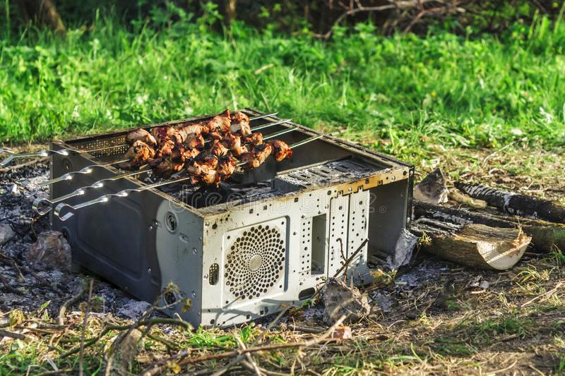 cooking-grilled-meat-outdoors-picnic-company-specialists-barbecue-grid-old-computer-case-cooki...jpg